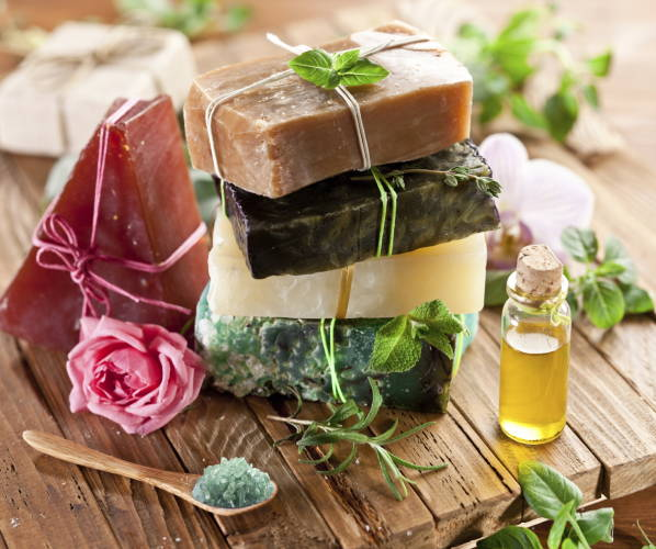 Piece of natural soap with herbs and flowers.